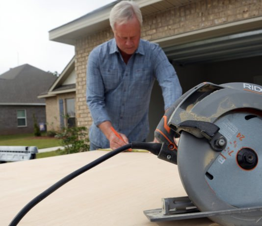 Circular saw in front of Danny
