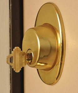 Key in deadbolt lock.