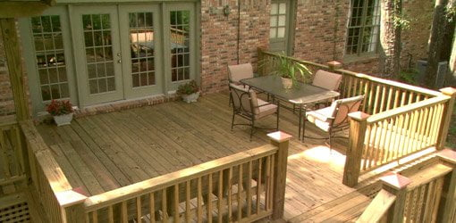 Wood deck with patio furniture.