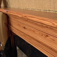 Mantel with faux heart pine graining.