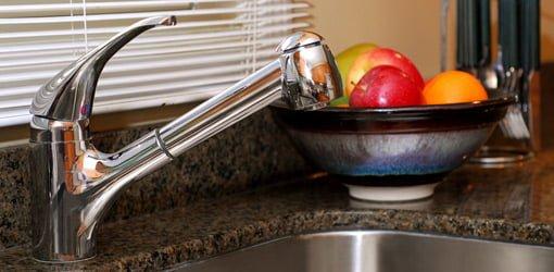 Chrome kitchen sink faucet.