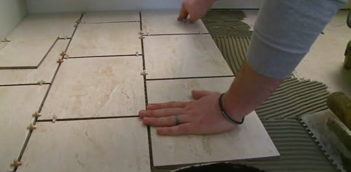 Laying tile floor.