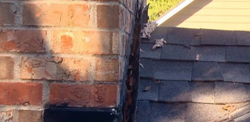 Flashing pulled away from chimney in need of repair.