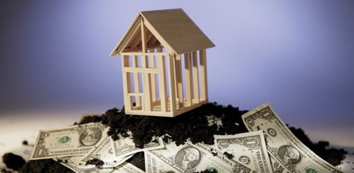 House on pile of money.