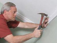Danny Lipford installing crown molding.