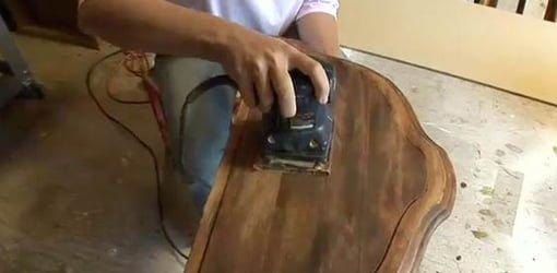 Sanding table top when refinishing.