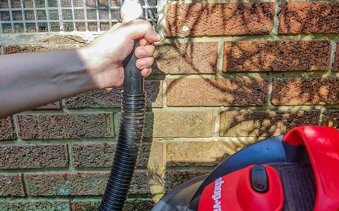 Unclogging an air conditioner's condensate drain line
