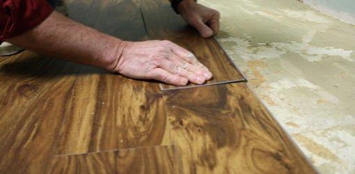 Installing vinyl plank flooring.