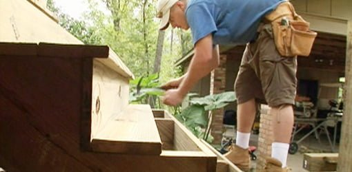 Attaching treads to the steps on a wood deck.