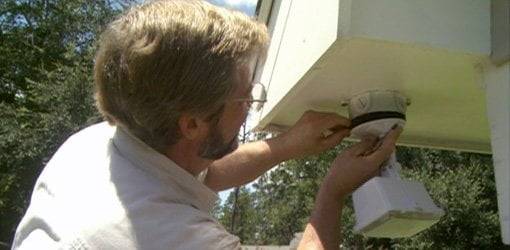 Installing a motion sensor outdoor security light.