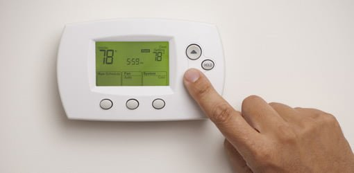 Setting a programmable setback thermostat.