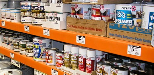 Cans of different paint primer on shelf at home center
