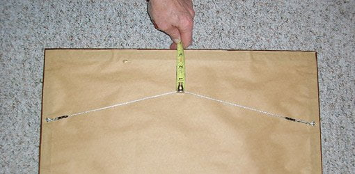 Measure from wire hanger to top of frame