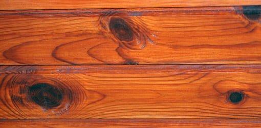 Knotty pine wood paneling.