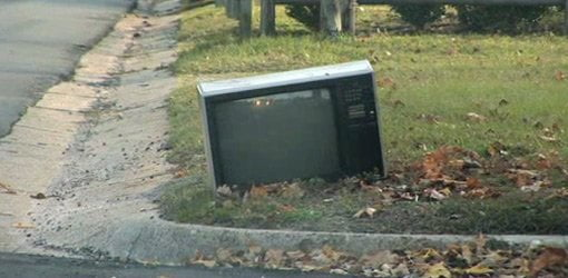 Old TV on curb for recycling.
