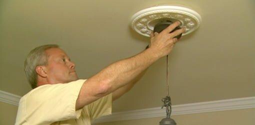 Danny Lipford installing a Chandelier.
