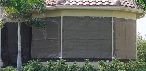 Fabric storm panels covering windows.