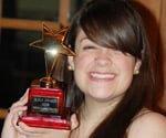 Joe Truini's daughter with acting award.