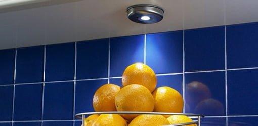 LED undercabinet light shining on oranges.