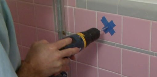 Drilling a hole in tile through masking tape.