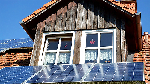 House with solar energy cell on the roof