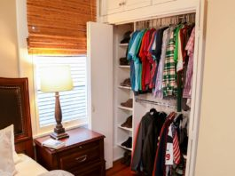 Bedroom closet with cubby holes for shoes and racks to hang shirts and jackets