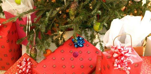 Presents under Christmas tree.