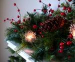 Christmas arrangement on fireplace mantel.