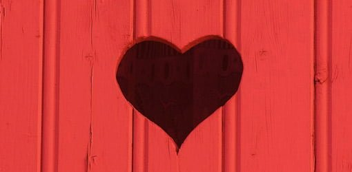 Heart shape cut in wood paneling