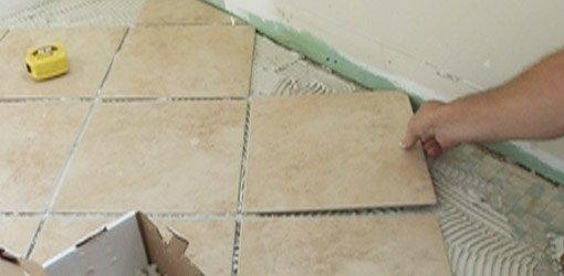 Laying diagonal tile on a bathroom floor.