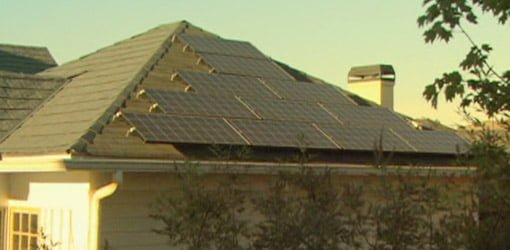 Solar photovoltaic panels on roof of home.