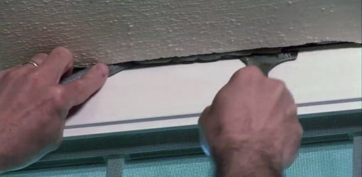 Using foam backer rod to fill a wide crack before caulking.