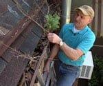 Joe cleaning gutter