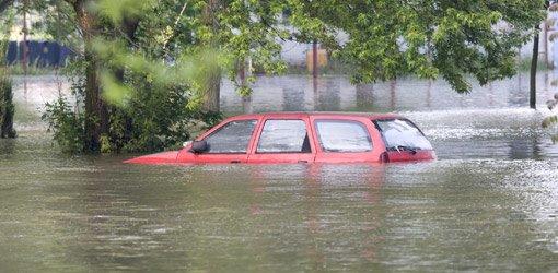 Car underwater in flood.