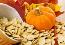 Roasted Pumpkin Seeds Spilling Out on the Table