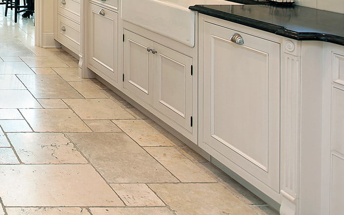 Closeup of stunning upscale kitchen floor with raised panel cabinets and the toe kick