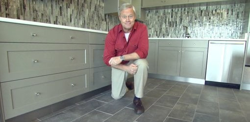 Danny Lipford in kitchen with dark gray natural stone floor.