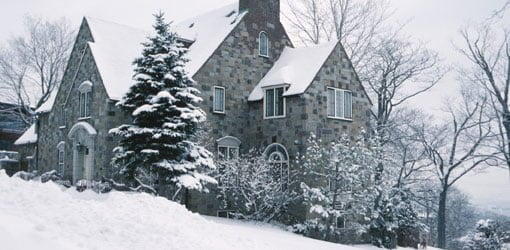 House surrounded by snow