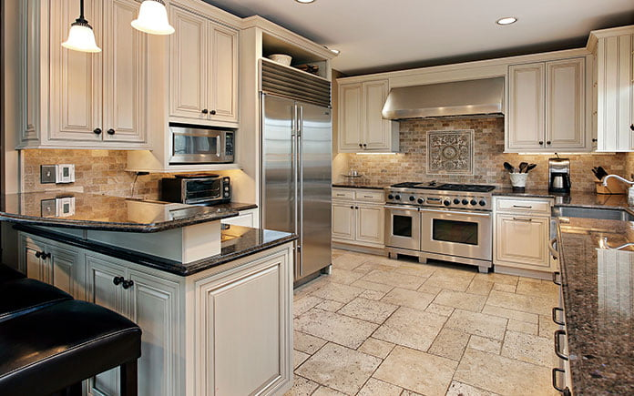 Upscale kitchen with gorgeous flooring and beautiful raised-panel cabinets