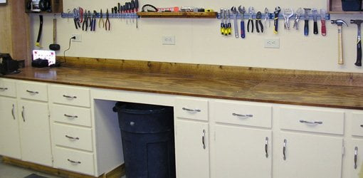 Workbench made from old kitchen cabinets with plywood top.