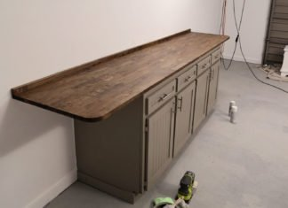 old cabinets are reused and turned into a workbench