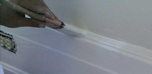 Painting baseboard.