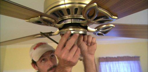Installing paddle ceiling fan.