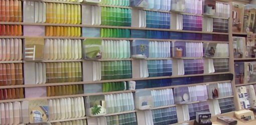 The paint section at a home center with hundreds of paint color choices.