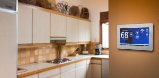 Smart thermostat installed on wall in the kitchen