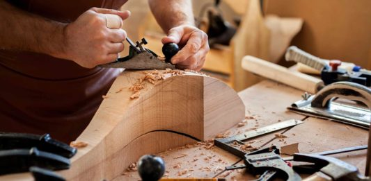 Man working on a wood project in his shop