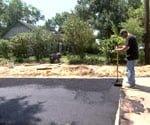 maninstalling asphalt driveway