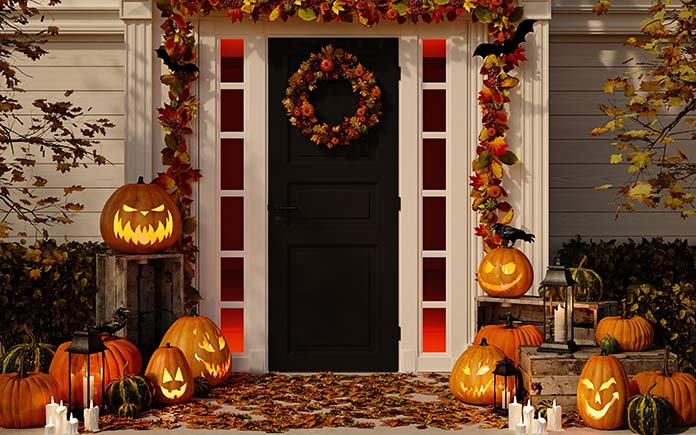Home exterior decorated for fall and Halloween