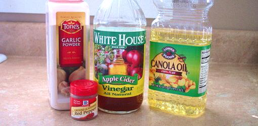 Containers of garlic, pepper, vinegar, and cooking oil