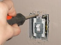 Removing screws on existing switch